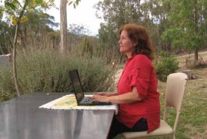 Maribel writing in the Australian bush