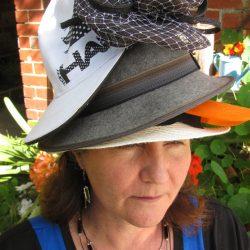 woman wearing hats