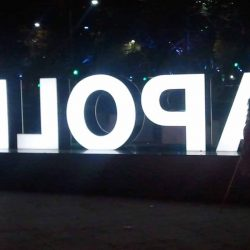 woman with illuminated sign
